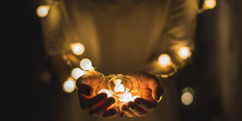 Holding small lights in hands